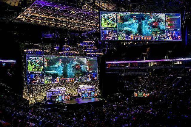 SEATTLE, WA - JULY 18: A sold out crowd fills the seats of Seattle's Key Arena at The International DOTA 2 Championships on July 18, 2014 in Seattle, Washington. (Photo by Suzi Pratt/FilmMagic)