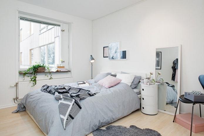светлое напольное покрытие в интерьере спальни в скандинавском стиле
